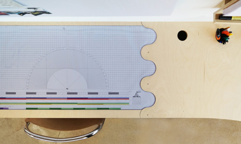 The model making space is made from a self-healing transparent plastic sheet with a customized ruler under it.