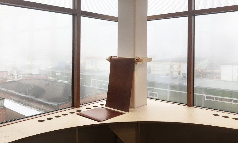 "A chair is integrated into the cabinet to sit and relax and look at ""Globen"" The biggest spherical building I the world."