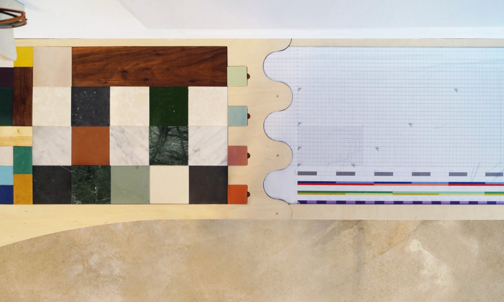 The bar is made from old material samples from different projects recessed into the plywood board.
