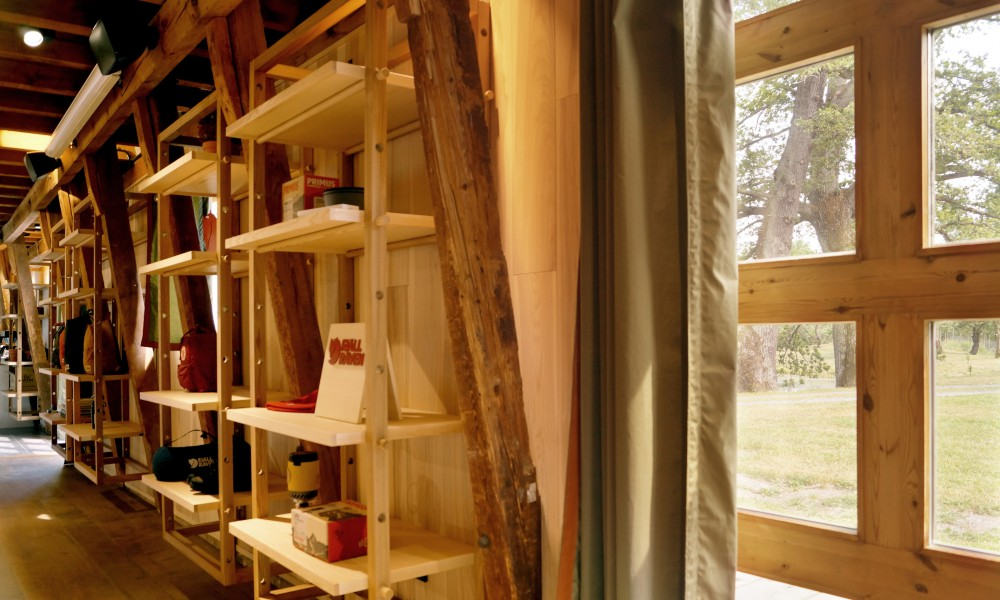 Shelves in lounge area with a view to the outside park
